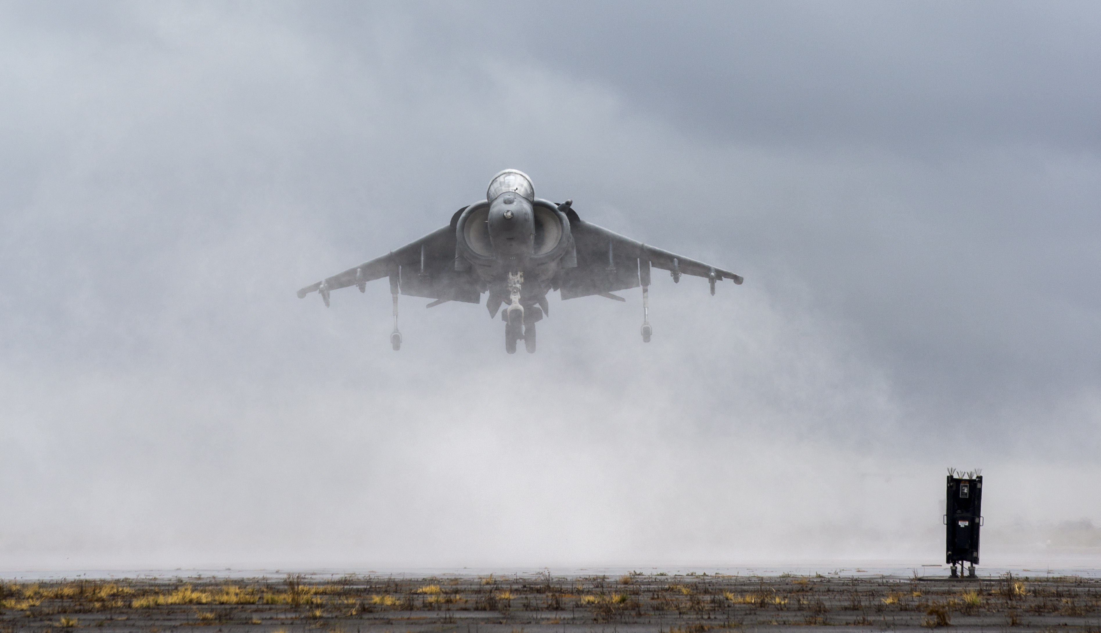 An AV-8B Harrier hovers during the Marine Corps Community Services sponsored 2015 Air Show aboard Marine Corps Air Station Miramar, San Diego, Calif., Oct. 4, 2015. The air show showcases civilian performances and the aerial prowess of the armed forces but also, their appreciation of the civilian community's support and dedication to the troops.